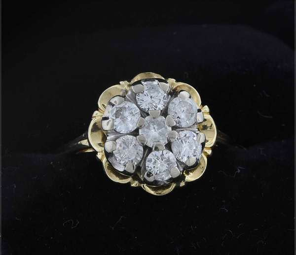 14kt (tested) yellow gold diamond cluster ring in buttercup setting set with approx. 1.0 ct. tw. round brilliant cut diamonds (H-I1), sz 8 1/2, 4.2 grams.  Condition: good, expect signs of normal wear.
