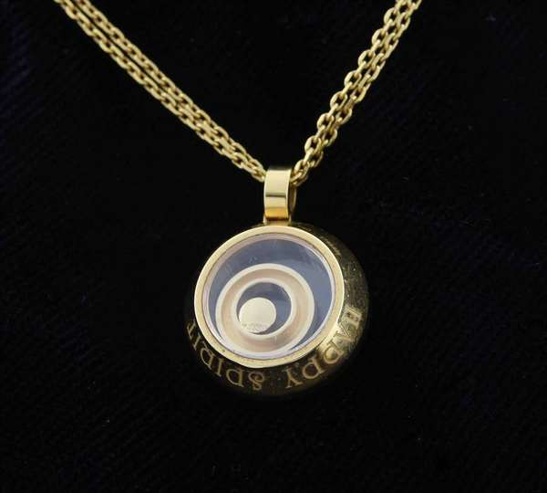 "18kt yellow gold signed Chopard ""Happy Spirit"" floating ring necklace set with approx. .09 ct. round brilliant cut diamond (G-VS), 17 mm round pendant, 16 in. long double chain, 14 grams.  Condition: very good, preowned, expect signs of normal wear."