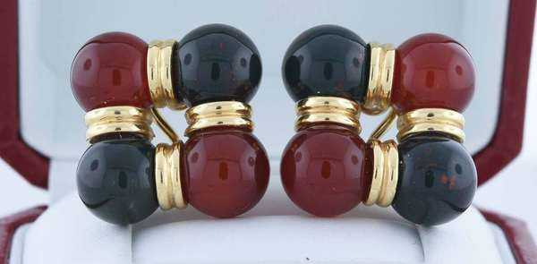 14kt yellow gold clip earrings set with eight spheres, 10 mm round bloodstone and carnelian, 1 inch, 18 grams.  Condition: very good, preowned, expect signs of normal wear.