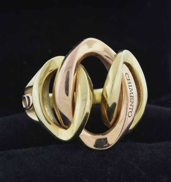 Signed Chimento 18kt yellow and rose gold ring with interlocking links design, 19.5 mm wide, sz. 7, 12.4 grams.  Condition: good, preowned, expect signs of normal wear.
