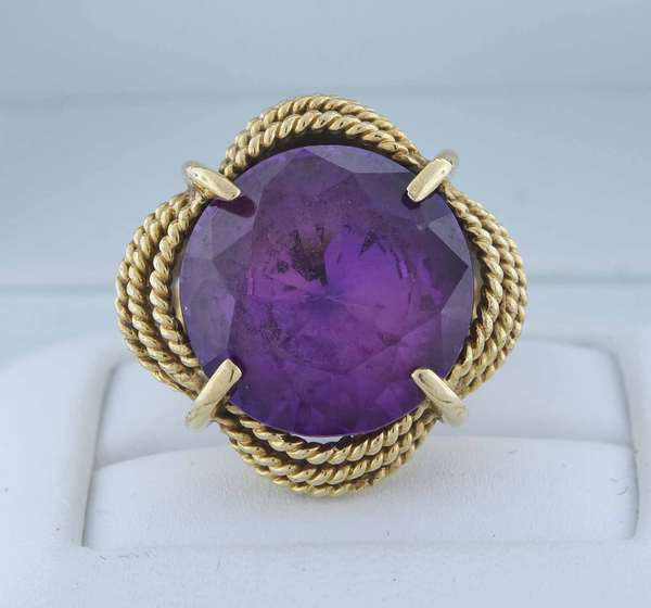 14kt yellow gold cushion shaped ring set with an approx. 10.7 ct. round modified brilliant cut amethyst, sz 6 3/4, 10.4 grams.  Condition: good condition, preowned expect signs of normal wear (loose stone)