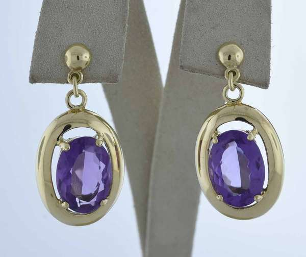 14kt (tested) yellow gold post (no backs) dangle earrings set with two approx. 16 ct. tw. oval amethysts, 1 1/4 in. long, 9.9 grams.  Condition: good, expect signs of normal wear.