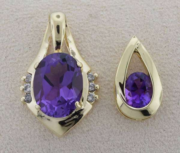 Two 14kt yellow gold amethyst pendants: one is set with an approx. 10 ct. amethyst accented by approx. .15 ct. tw. round brilliant cut diamonds (K-L-I1), 1 1/4 in. long, 6.2 grams and the other teardrop shaped pendant is set with an approx. 1-1.5 ct. oval amethyst, approx. 1 in. long,  2.5 grams. (2)  Condition: very good, expect signs of normal wear.