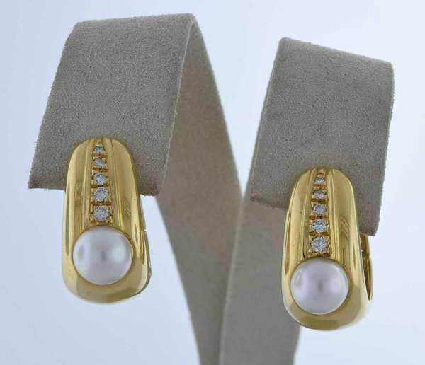 18kt yellow gold huggie hoop earrings with posts fastened by hinged closures, 7 mm round white pearls with good luster accented by approx. .14 ct. tw. round brilliant cut diamonds (G-H-VS-SI), 11 mm wide at bottom, 3/4 in. long, 11.6 grams.  Condition: very good, preowned, expect signs of normal wear.