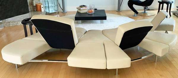 "Francesco Binfare (Italian, B. 1939). 'Flap' Sofa for Edra, Italy, circa 2000. Beige leather with chromed metal base and legs. Together with spare new tan leather cover by Edra, Italy. An example of this sofa is currently at MoMa, New York. 11'9"" left to right corner x 52""D. x 14""H.  Condition: In overall very fine structural condition. The original leather upholstery with some ingrained dirt. The tan cover in new condition."