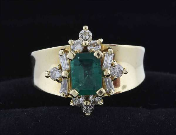 14kt yellow gold emerald and diamond ring set with an approx. .85ct slightly bluish green, moderately to heavily included, emerald cut emerald with strong saturation, accented by approx. .60 ct. tw. round brilliant cut and tapered baguette diamonds (G-H-VS), sz. 7 3/4, 6.4 grams.  Condition: very good, preowned, expect signs of normal wear.