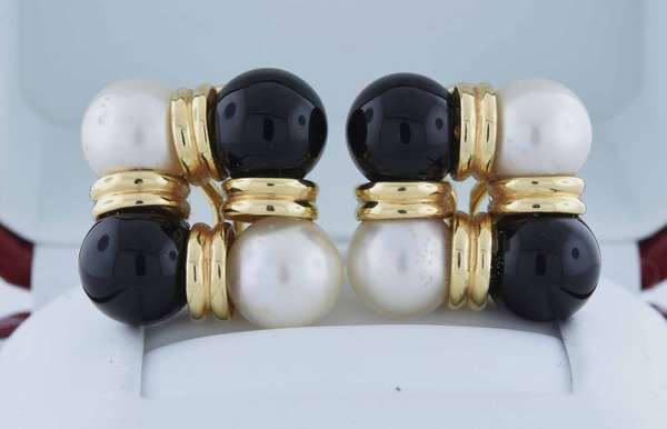 14kt yellow gold clip earrings set with eight spheres, 9 mm round black onyx and cultured white pearl, approx. 1 inch, 15.3 grams.  Condition: good, preowned, expect signs of normal wear.