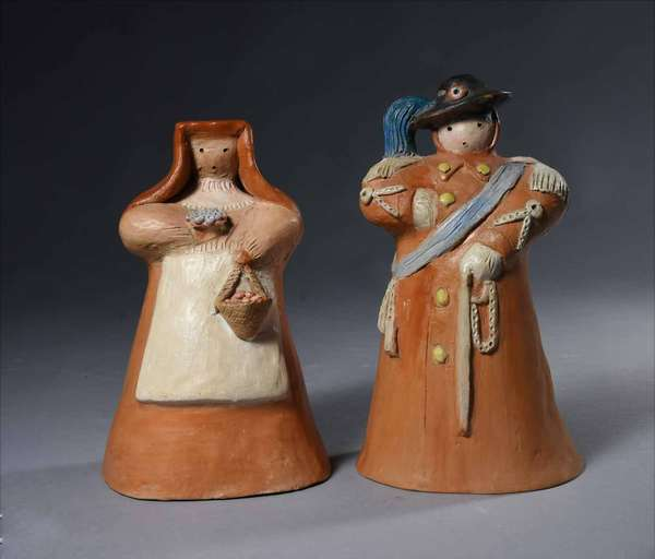 "Alf Gaudenzi (Italian, 1908 - 1980). Bersagliere (Sharpshooter) together with Donna di Sicilia (Woman of Sicily), circa 1950. Both paint-decorated terracotta, the base interiors with artist initials ""A.G."" and old paper labels denoting artist, place of origin, and title. Height of first 8"", height of second 7 1/4"".  Condition: In overall very fine condition. Each with negligible light abrasions throughout. The sharpshooter with some inpainting on his proper right arm."