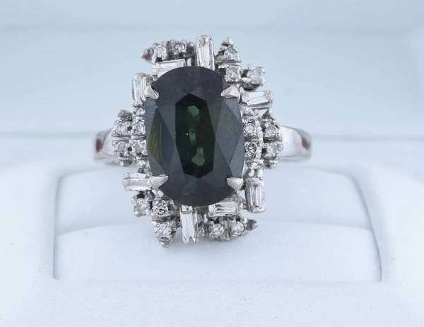 Lady's 18k wg tourmaline and diamond ring, approx. 4.0 ct dark green tourmaline accented by approx. .50 ctw single cut and tapered baguette diamonds (H-I-VS SI), size 8 1/2, 7.0 grams.  Condition: good