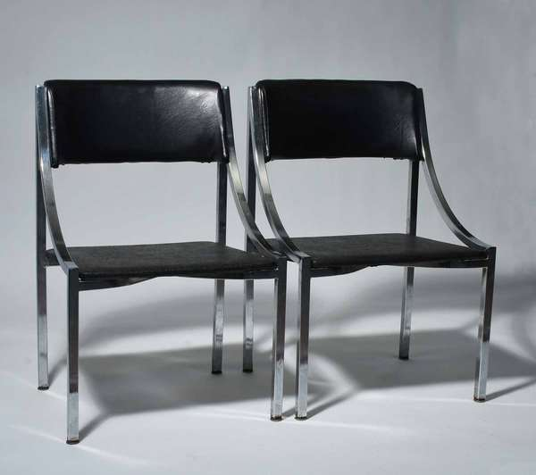 "Wolfgang Hoffmann (Austrian, 1900 - 1969). Side Chairs in Chrome and Vinyl, 1950s. Manufactured by Howell Company, the underside with old Howell label, 31"" H, 19 1/2"" W, 17 3/4"" D, 15 1/2"" Seat Height.  Condition: In overall fine condition. The chrome legs with some rust and light pitting. The leather seats with some ingrained dust and general wear. One of the seat backs with a drip mark that can likely be removed at home."