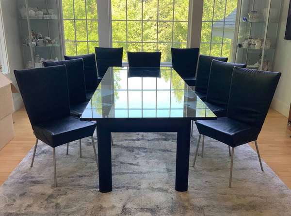 "Set of Ten Designo Swiss-Made Black Leather Dining Chairs, 21st century. On metal bases and legs, 35""H x 17""W x 18"" seat height.  Condition: In overall very fine condition. Some of the seats with minor abrasions. The legs with some abrasions commensurate with use."