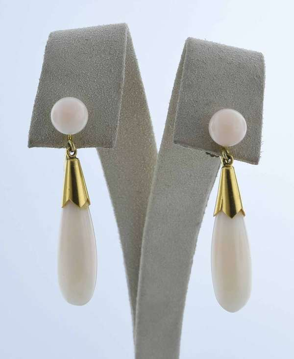 Pair of 14K coral earrings, tear drop form with angel skin coral drops, screw backs, approx. 1.5
