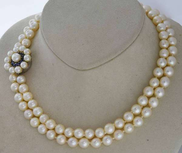 "Vintage double strand pearl necklace with 14k white gold sapphire and diamond clasp, 15""L with 7/8""D round clasp and 6.8 to 7.7 mm pearls.  Condition: overall good good luster."