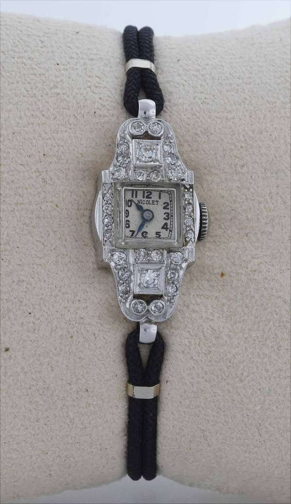 "1920's Art Deco platinum diamond (tested metal and stamped) Armand Nicolet woman's wristwatch on black cord band, clasp stamped 1/20-12k, approx. .50 ctw single cut diamonds, 6""L., 11.5 grams, working.  Condition: good, working"
