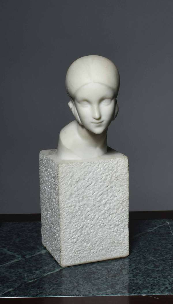 "Georges Coste carved white marble Deco era female bust, signed on top of textured plinth, 12"" overall height X 6"" D X 4.25"" W Condition: as found, no evidence of chipping or damage."