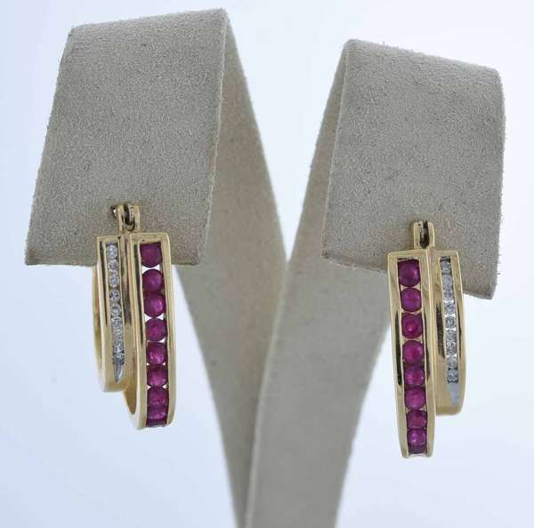 10kt yellow gold ruby and diamond hoop earrings approx. 1.0ct tw rubies and approx. .18ct tw round brilliant cut diamonds, 5.4 grams.  Condition: good.
