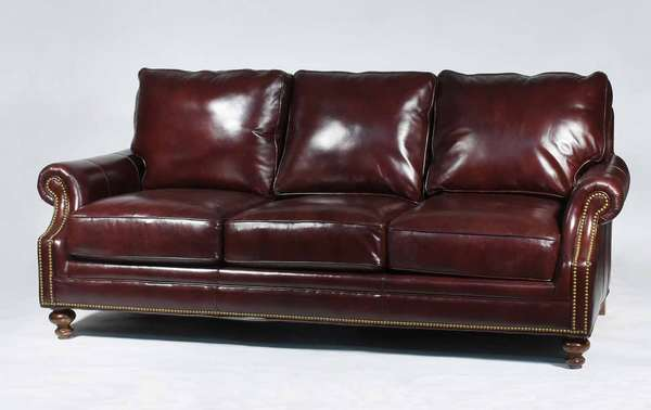 Bradington Young burgundy leather three-cushion sofa. Classic design with brass tack details and removable cushions. Height 30