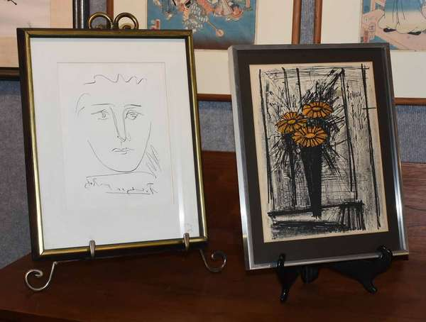 "Pablo Picasso (Spanish/French, 1881 - 1973) and Bernard Buffet (French, 1928 - 1999). Two prints: Pour Robbie and Flower, early-mid-century. The first etching signed and titled ""Picasso Pour Robbie"" in the plate l.c. With old certificate of authentication on verso. Sight 9 5/8"" x 7 1/2"", frame 15 1/4"" x 12"". The second signed ""Bernard Buffet"" in the lithographic stone u.r. With old certificate of authentication and newspaper clippings about the artist on verso.  Condition: Neither examined out of frame. The first in overall very fine condition with no issues detected. The second with general toning throughout commensurate with age."