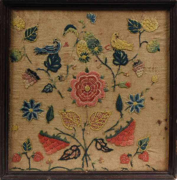 "18TH C. FLORAL NEEDLEWORK WITH BIRDS. Likely an American example initialed ""M C"". Depicts two doves perched amongst a colorful floral display with strawberries and other fruit clusters. Dyed wool thread on linen. 10.5"" X 10"" sight size, in an old 11"" X 11.25"" frame.Condition: not examined out of frame, showing some thread loss, some staining, small hole (see images)"