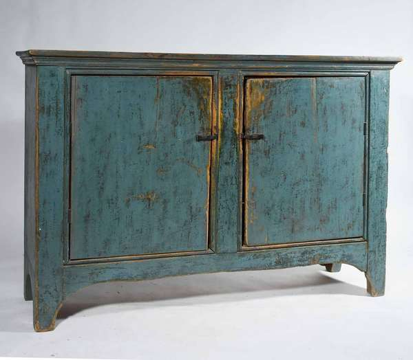 "19TH C. AMERICAN BLUE PAINTED FLOOR CUPBOARD. With arched cut out base and two plank doors, hand forged iron latches, and molded top, 42"" H x 15 1/2"" D x 57"" L. Condition: Structurally sound, likely altered from a different form. Worn blue paint, back boards old but not original."