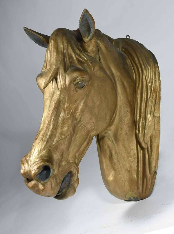 "19TH C. FRENCH ZINC HORSE HEAD TRADE SIGN. Very well executed repousse with a gilt paint over previous layers, 26"" H X 19"" D X 13"" W - Condition: Several areas with fracture to the zinc, flaking and loss to surface, ears have splitting at connection to head, old farm repair to a split in zinc on side."