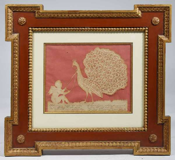 "19TH C. AMERICAN CUT PAPER & INK SCHERENSCHNITTE. Finely executed cherub holding the reins on a fanning peacock, inscribed with ink verse, paper is approx 7"" x 9"" in a quality vintage frame, 16 1/2"" X 18"". Condition: Some paper toning/staining, blade of grass is torn."