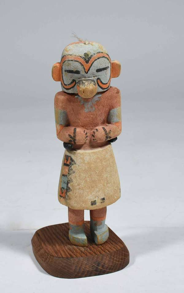 "CA. 1900 HOPI COTTONWOOD KACHINA DOLL. With old multi-color pigment paint on stand, 7"" H x 2 1/2"" W. Condition: some paint wear and loss, touch-up."