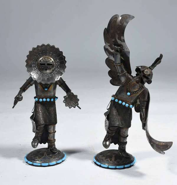 "TWO WILFORD BEGAY NAVAJO SILVER KACHINA FIGURES. Turquoise mounted sterling dancing Native Am. figures, signed and labeled on bottom, 8 1/2"" & 10 1/2"" H. Condition: overall good, condition."