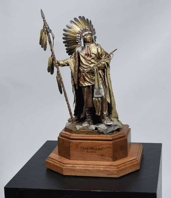 "DAVE MCGARY, BRONZE 'CHIEF WASHAKIE'. Cold painted bronze of Native Am. chief, on custom swiveling inscribed walnut pedestal and signed on bronze, 14 1/2"" H (bronze) 19"" H on pedestal.  Condition: good overall condition."