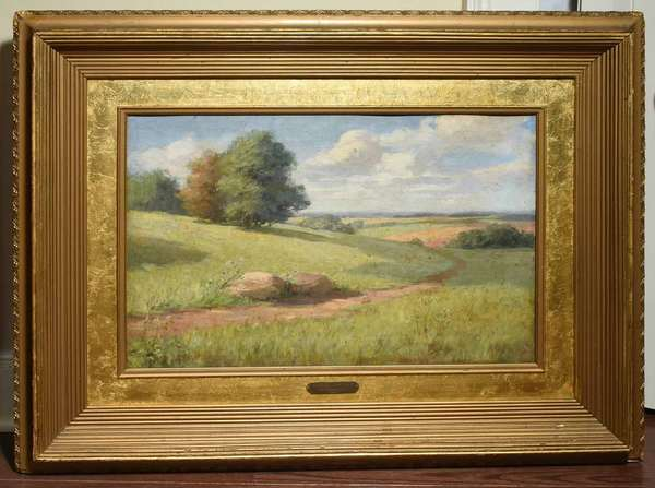 "FREDERICK MULHAUPT, O/C, SUMMER LANDSCAPE, 1899.Impressionist landscape with winding path through rolling hills. Period brass plaque reads ""Englewood Woman's Club, F. Mulhaupt 1906"" signed on canvas l/l ""FRED'K J. MULHAUPT. 1899. 16"" X 24"" (image) 28"" X 36"" (frame) Condition: canvas has been laid onto masonite and shows light spotted in-painting throughout with more around previous stretcher wear. Slight flaking and craquelure with in-grained dirt. Frame with with some losses and wear."