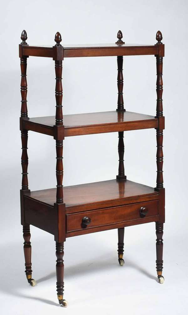 "FEDERAL MAHOGANY ETEGERE/WHATNOT. Ca. 1820, possibly Boston, three tiers with acorn finials, the lower section with one dovetailed mahogany drawer on turned legs and cup caster feet. Period wood pulls and early surface, 44"" H x 13"" D x 20"" W. Condition overall good early rich finish and original porcelain caster feet."