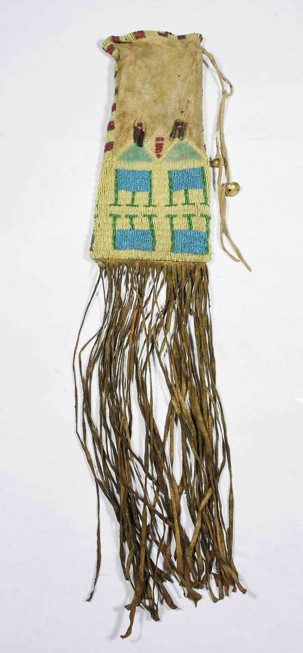 NORTHERN PLAINS BEADED PIPE BAG. Sinew sewn native tanned leather, multi-color beads on yellow ground with tin cones, 30