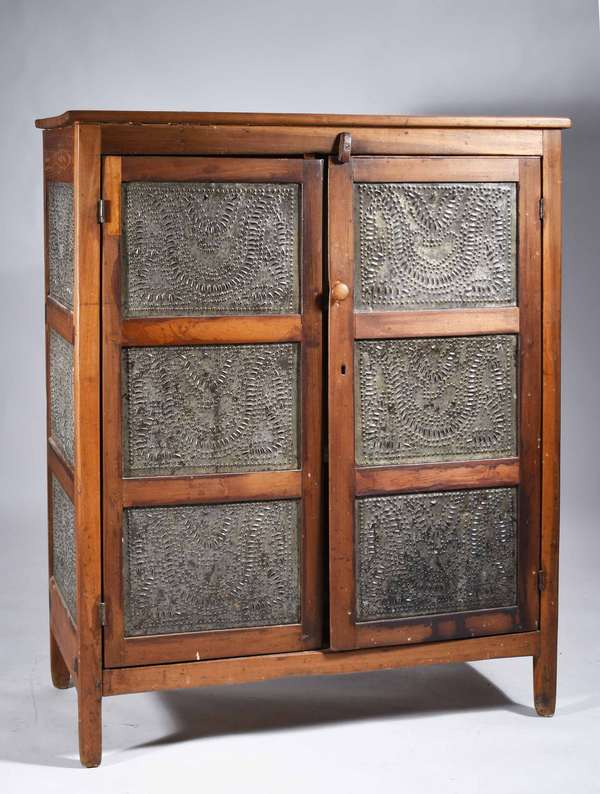 "MID 19TH C. POPLAR TWO-DOOR PIE SAFE. With heart design punched tin panels on three sides, fitted with two interior painted shelves, 45 3/4"" H x 38 1/2"" W x 16"" D.   Condition: In good country condition with consistent wear. Some replaced hardware, interior latch, knob, and some pieced areas."