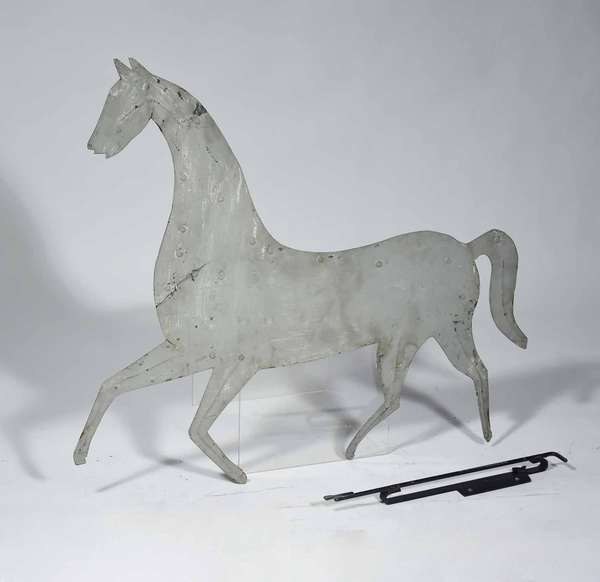 "LATE 19TH C. 'HORSE' SHEET METAL WEATHERVANE. With historic gray paint and modern wall mount, 30 1/4"" H x 33 1/2"" L.  Condition: Soiling throughout and some flaking near mane and hind. A 5"" stabilized tear at breast and 2"" stabilized tear on front leg. Loss of the tip of the tail."