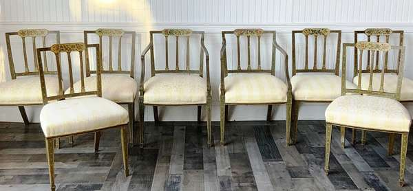 "SET OF 8 ENGLISH PAINT DECORATED HEPPLEWHITE DINING CHAIRS.  Ca 1800, consisting of 2 arm chairs and 6 side chairs, with floral and other paint decoration, over upholstered seats and tapered legs ending in spade feet, with pegged construction.  33"" Back H, x 20"" W x 18""Seat H.  Condition. Seat frames re-enforced inside original frames some patches, areas of paint decoration later, stains in seat fabric."