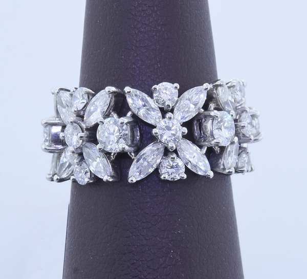 TIFFANY & CO. PLATINUM DIAMOND FLEXIBLE RING.  Approx. 5.7 ct. tw. round brilliant and marquise cut diamonds, G-H-VS, sz. 5 3/4, 9.8 grams.  Good condition - New bidders to Smiths - Payment for this lot must be made with Cash, Certified Check or Wire Transfer. NO CREDIT CARDS or Pay Pal accepted. Items will be held by Smiths until payment has cleared.