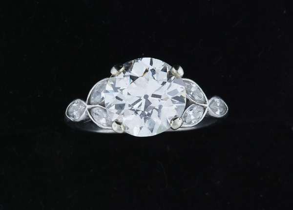 3.30 CT. OLD EUROPEAN CUT DIAMOND PLATINUM RING.  An approx. 3.3-3.4 ct. Old European cut diamond, K-VS (small chips on girdle) is set between six, marquise cut diamonds, approx. .50 ct. tw., G-H-VS-SI, sz. 6 1/2, 3/9 gr. Condition: good, small chips on the girdle of center stone, normal wear - New bidders to Smiths - Payment for this lot must be made with Cash, Certified Check or Wire Transfer. NO CREDIT CARDS or Pay Pal accepted. Items will be held by Smiths until payment has cleared.