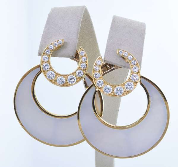BULGARI 18K GOLD DIAMOND AND MOTHER OF PEARL EARRINGS.  The stamped and signed 18 karat yellow gold post with omega clip back earrings, feature an inlaid crescent shaped mother of pearl that dangles from a crescent shaped diamond set piece at the top, approx. 2.36 ct. tw. of round brilliant cut diamonds, G-VS, very good cut, 1 3/4 in. long, 30.3 gr.  Condition: very good - New bidders to Smiths - Payment for this lot must be made with Cash, Certified Check or Wire Transfer. NO CREDIT CARDS or Pay Pal accepted. Items will be held by Smiths until payment has cleared.