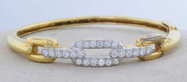 DAVID WEBB 18K GOLD, PLATINUM AND DIAMOND BANGLE. A yellow gold chain link motif bracelet, that is topped with platinum and set with approx. 2 ct. tw. round brilliant cut diamonds, G-H-VS, very good cut, signed, 6 in., 23.6 gr. Condition: good - New bidders to Smiths - Payment for this lot must be made with Cash, Certified Check or Wire Transfer. NO CREDIT CARDS or Pay Pal accepted. Items will be held by Smiths until payment has cleared.