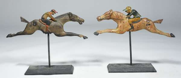 """PAIR OF FOLK ART HORSE RACING TABLETOP GAME FIGURES. 13""""H x 15.5""""W x 4""""D.  In a charming vintage patina. Condition: One jockey is missing left hand, chips and fading in paint, cracks where legs attach to horses."""
