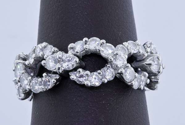 TIFFANY & CO. PLATINUM DIAMOND FLEXIBLE INFINITY BAND.  Approx. 2.5 ct. tw. round brilliant and marquise cut diamonds, G-H-VS, sz. 6 1/4, 7.2 grams. Condition: good - New bidders to Smiths - Payment for this lot must be made with Cash, Certified Check or Wire Transfer. NO CREDIT CARDS or Pay Pal accepted. Items will be held by Smiths until payment has cleared.