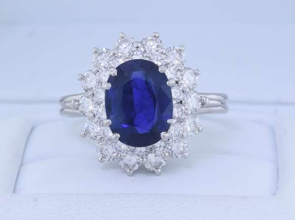 TIFFANY & CO. PLATINUM SAPPHIRE AND DIAMOND RING.  The hand fabricated platinum (tested) ring is set with an approx. 2.75 ct. oval blue sapphire, moderately included, with a dark violet 'ish blue color, accented by approx. 1.80 ct. tw. round brilliant cut diamonds, sz. 8, 7.4 gr.  Condition: good - New bidders to Smiths - Payment for this lot must be made with Cash, Certified Check or Wire Transfer. NO CREDIT CARDS or Pay Pal accepted. Items will be held by Smiths until payment has cleared.