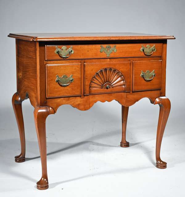 """18TH C. CT QUEEN ANNE CHERRY LOWBOY: two board top with notched corners above one long, over three short, drawers, a center drawer with shell carving, on well formed cabriole legs and pad feet.  30""""H x 29""""case W x 18""""D. Condition: pleasant older refinish, replaced brasses and other repair"""