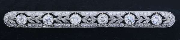 ART DECO PLATINUM DIAMOND BAR PIN.  The pin is set with 6, Old European cut diamonds, approx. 3.0 ct. tw., H-J-VVS-VS, accented by approx. 2.8 ct. tw. OE full cut diamonds, gold pin stem, 3 inches long, 9.4 grams.  Very good condition.- New bidders to Smiths - Payment for this lot must be made with Cash, Certified Check or Wire Transfer. NO CREDIT CARDS or Pay Pal accepted. Items will be held by Smiths until payment has cleared.