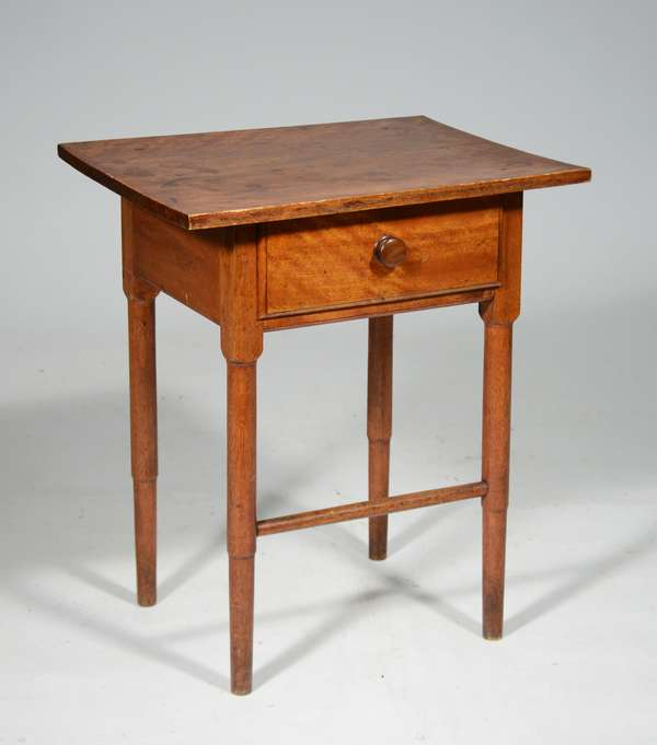 """19TH C. SHAKER ONE DRAWER BIRCH STAND: small size with a rectangular top, one dovetailed drawer, bottle legs and single turned stretcher with traces of old red stain. 22""""H x 19""""W x 14.5""""D Condition: structurally sound, overall good"""