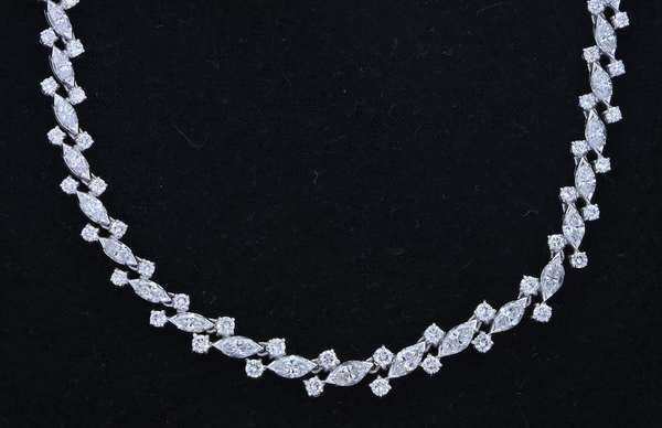 """115 CARAT MARQUISE & ROUND DIAMOND PLATINUM NECKLACE. Approx. 15 ct. two round brilliant and marquise cut diamonds are set into this lovely necklace, F-G-VS, 6-7 mm wide, 15 1/2""""L 42.5 gr.  Condition: very good. - New bidders to Smiths - Payment for this lot must be made with Cash, Certified Check or Wire Transfer. NO CREDIT CARDS or Pay Pal accepted. Items will be held by Smiths until payment has cleared."""