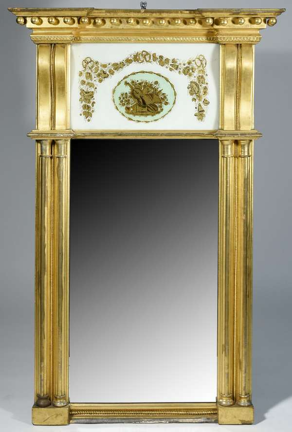 """AMERICAN FEDERAL ARCHITECTURAL EGLOMISE MIRROR CA. 1810. This is a prime example. Mirror has large double columns along the sides, hand painted music scene in mirror header, original gilded finish.  54.5""""H x 35.5""""W x 6.5""""D  Condition: Mirror is in remarkable condition."""
