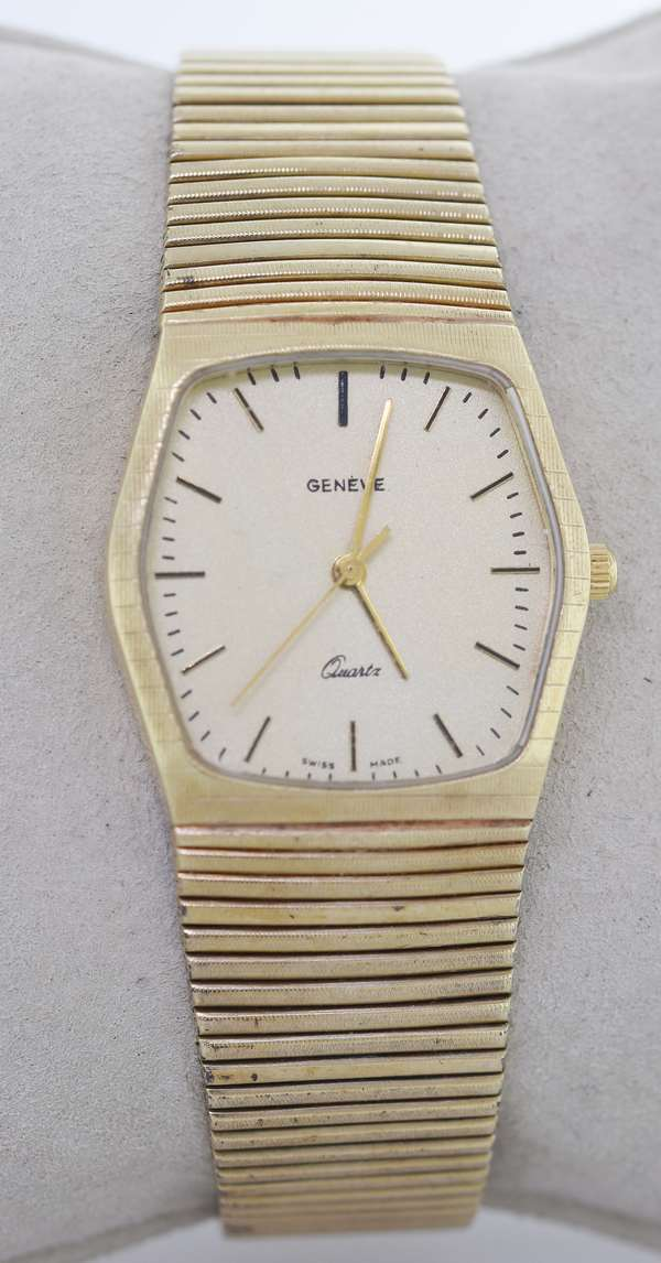 MAN'S 14KT YELLOW GOLD GENEVE QUARTZ WRIST WATCH.  Hexagonal dial, monogram, dash numerals, baton style hands, stamped 14KT, 585, Italy, 29 mm, 8 1/8 in. long, 81.5 grams.  Good condition. - New bidders to Smiths - Payment for this lot must be made with Cash, Certified Check or Wire Transfer. NO CREDIT CARDS or Pay Pal accepted. Items will be held by Smiths until payment has cleared.