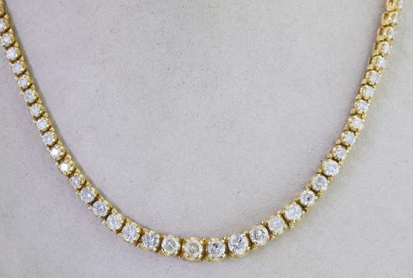 14KT YELLOW GOLD GRADUATED DIAMOND LINE NECKLACE.  Approx. 9.0 ct. tw. round brilliant cut diamonds, H-I-J-I1-I2, 16 inches long, 28.7 grams.  Good condition. - New bidders to Smiths - Payment for this lot must be made with Cash, Certified Check or Wire Transfer. NO CREDIT CARDS or Pay Pal accepted. Items will be held by Smiths until payment has cleared.