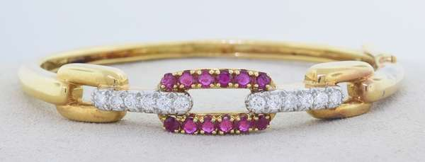 DAVID WEBB 18K GOLD PLATINUM DIAMOND AND RUBY BANGLE. The yellow gold bracelet chain link motif that is topped with platinum set with approx. 1.0 ct. tw. round brilliant cut diamonds, G-H-VS, very good cut, and approx. .75 ct. tw. round brilliant cut medium dark red rubies, signed, 6 in., 22.2 gr. Good condition. - New bidders to Smiths - Payment for this lot must be made with Cash, Certified Check or Wire Transfer. NO CREDIT CARDS or Pay Pal accepted. Items will be held by Smiths until payment has cleared.